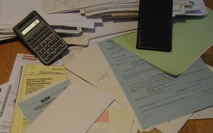 Pile of cluttered papers on a desk