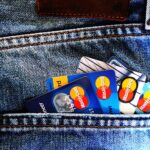 Image of credit cards sticking out of denim back pocket by TheDigitalWay from Pixabay
